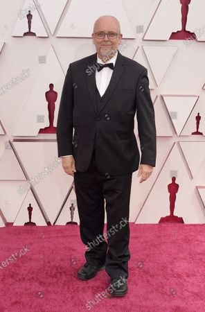 Stock Image of Mark Coulier arrives for the 93rd annual Academy Awards ceremony at Union Station in Los Angeles, California, USA, 25 April 2021. The Oscars are presented for outstanding individual or collective efforts in filmmaking in 24 categories. The Oscars happen two months later than originally planned, due to the impact of the coronavirus COVID-19 pandemic on cinema.