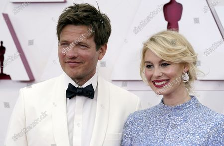 Thomas Vinterberg (L) and Helene Reingaard Neumann arrive for the 93rd annual Academy Awards ceremony at Union Station in Los Angeles, California, USA, 25 April 2021. The Oscars are presented for outstanding individual or collective efforts in filmmaking in 24 categories. The Oscars happen two months later than originally planned, due to the impact of the coronavirus COVID-19 pandemic on cinema.