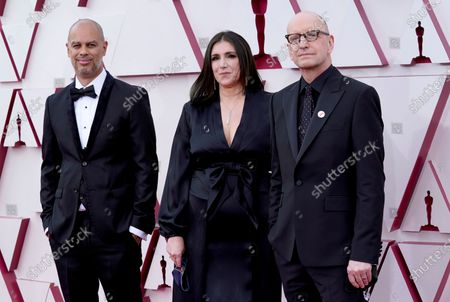 Jesse Collins, Stacey Sher, and Steven Soderbergh arrive for the 93rd annual Academy Awards ceremony at Union Station in Los Angeles, California, USA, 25 April 2021. The Oscars are presented for outstanding individual or collective efforts in filmmaking in 24 categories. The Oscars happen two months later than originally planned, due to the impact of the coronavirus COVID-19 pandemic on cinema.