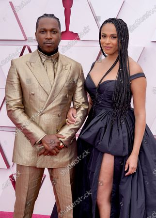 Leslie Odom Jr. (L) and Nicolette Robinson arrive for the 93rd annual Academy Awards ceremony at Union Station in Los Angeles, California, USA, 25 April 2021. The Oscars are presented for outstanding individual or collective efforts in filmmaking in 24 categories. The Oscars happen two months later than originally planned, due to the impact of the coronavirus COVID-19 pandemic on cinema.
