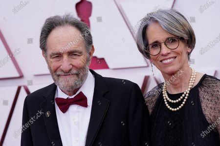 Eric Roth (L) and Debra Greenfield arrive for the 93rd annual Academy Awards ceremony at Union Station in Los Angeles, California, USA, 25 April 2021. The Oscars are presented for outstanding individual or collective efforts in filmmaking in 24 categories. The Oscars happen two months later than originally planned, due to the impact of the coronavirus COVID-19 pandemic on cinema.