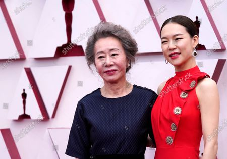 Youn Yuh-jung (L) and Han Ye-ri arrive for the 93rd annual Academy Awards ceremony at Union Station in Los Angeles, California, USA, 25 April 2021. The Oscars are presented for outstanding individual or collective efforts in filmmaking in 24 categories. The Oscars happen two months later than originally planned, due to the impact of the coronavirus COVID-19 pandemic on cinema.