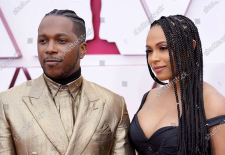 Leslie Odom Jr. (L) and Nicolette Robinson arrive for the 93rd annual Academy Awards ceremony at Union Station in Los Angeles, California, USA, 25 April 2021. The Oscars are presented for outstanding individual or collective efforts in filmmaking in 24 categories. The Oscars happen two months later than originally planned, due to the impact of the coronavirus COVID-19 pandemic on cinema.   *** Local Caption *** 55864152