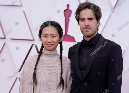 Chloe Zhao (L) and Joshua James Richards arrive for the 93rd annual Academy Awards ceremony at Union Station in Los Angeles, California, USA, 25 April 2021. The Oscars are presented for outstanding individual or collective efforts in filmmaking in 24 categories. The Oscars happen two months later than originally planned, due to the impact of the coronavirus COVID-19 pandemic on cinema.