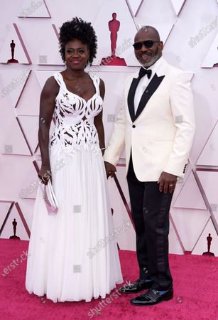Viola Davis (L) and Julius Tennon arrive for the 93rd annual Academy Awards ceremony at Union Station in Los Angeles, California, USA, 25 April 2021. The Oscars are presented for outstanding individual or collective efforts in filmmaking in 24 categories. The Oscars happen two months later than originally planned, due to the impact of the coronavirus COVID-19 pandemic on cinema.