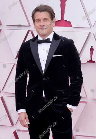Stock Photo of Mark Ricker arrives for the 93rd annual Academy Awards ceremony at Union Station in Los Angeles, California, USA, 25 April 2021. The Oscars are presented for outstanding individual or collective efforts in filmmaking in 24 categories. The Oscars happen two months later than originally planned, due to the impact of the coronavirus COVID-19 pandemic on cinema.