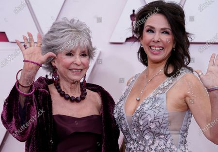 Rita Moreno (L) and Fernanda Luisa Gordon arrive for the 93rd annual Academy Awards ceremony at Union Station in Los Angeles, California, USA, 25 April 2021. The Oscars are presented for outstanding individual or collective efforts in filmmaking in 24 categories. The Oscars happen two months later than originally planned, due to the impact of the coronavirus COVID-19 pandemic on cinema.