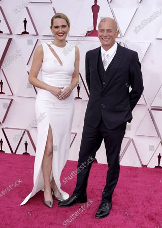 Jena Friedman (L) and Anthony Hines arrive for the 93rd annual Academy Awards ceremony at Union Station in Los Angeles, California, USA, 25 April 2021. The Oscars are presented for outstanding individual or collective efforts in filmmaking in 24 categories. The Oscars happen two months later than originally planned, due to the impact of the coronavirus COVID-19 pandemic on cinema.