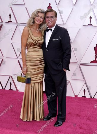 Paulina Porizkova (L) and Aaron Sorkin arrive for the 93rd annual Academy Awards ceremony at Union Station in Los Angeles, California, USA, 25 April 2021. The Oscars are presented for outstanding individual or collective efforts in filmmaking in 24 categories. The Oscars happen two months later than originally planned, due to the impact of the coronavirus COVID-19 pandemic on cinema.