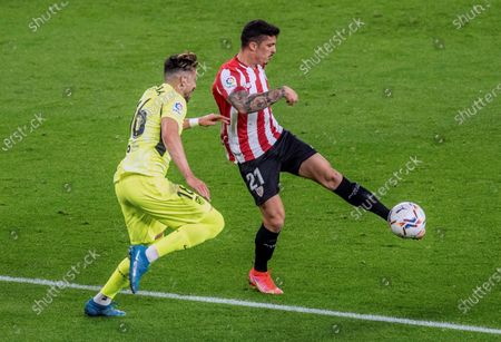 Stock Image of Athletic's defender Ander Capa (R) vies for the ball against Atletico's Mexican midfielder Hector Herrera (L) during the Spanish LaLiga soccer match between Athletic Club and Atletico de Madrid at San Mames stadium in Bilbao, Basque Country, Spain, 25 April 2021.