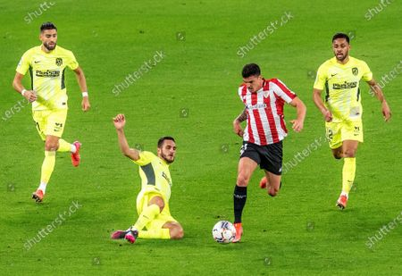 Athletic's defender Ander Capa (2-R) vies for the ball against Atletico's midfielder Koke Resurreccion (2-L) during the Spanish LaLiga soccer match between Athletic Club and Atletico de Madrid at San Mames stadium in Bilbao, Basque Country, Spain, 25 April 2021.