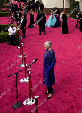 Glenn Close is interviewed on the red carpet at the Oscars