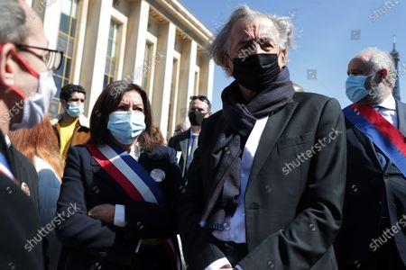 Anne Hidalgo, Bernard-Henri Levy waits during the demonstration against the decision of the Court of Cassation in the Sarah Halimi case