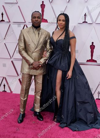 Leslie Odom Jr., left, and Nicolette Robinson arrive at the Oscars, at Union Station in Los Angeles