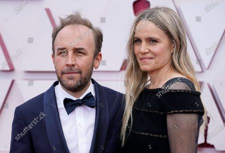 Stock Photo of Derek Cianfrance, left, and Shannon Plumb arrive at the Oscars, at Union Station in Los Angeles
