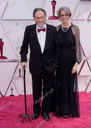 Stock Picture of Eric Roth, left, and Debra Greenfield arrive at the Oscars, at Union Station in Los Angeles