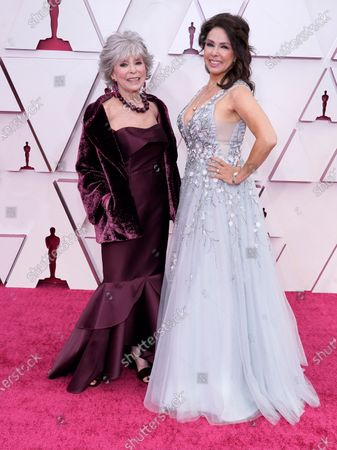 Rita Moreno, left, and Fernanda Luisa Gordon arrive at the Oscars, at Union Station in Los Angeles