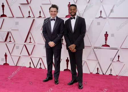 Stock Picture of Ben Proudfoot, left, and Kris Bowers arrive at the Oscars, at Union Station in Los Angeles