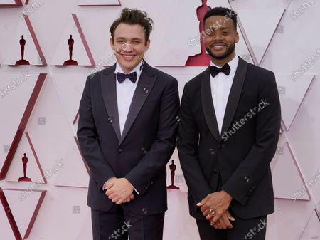 Ben Proudfoot, left, and Kris Bowers arrive at the Oscars, at Union Station in Los Angeles