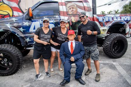 Bianca Gracia, from left, Maria Miller, and Enrique Tarrio pose for a photo at the 'Patriots Day Bash' at Mickey's Tiki Bar on April 25, 2021 in Pompano Beach, FL.