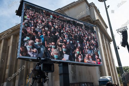 The crowd filmed in the giant screen during the demonstration to demand justice for the killing of Sarah Halimi, in 2017. In the Trocadero square, in Paris, on April 25, 2021.