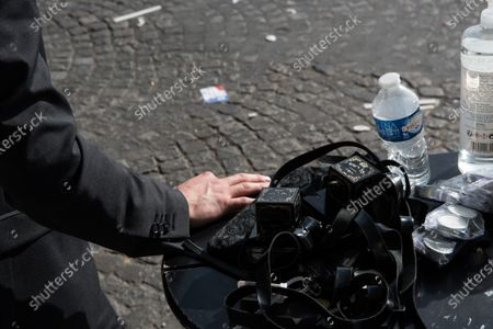 "Stock Photo of Disinfectant liquid for hands, water and ""battim"" for the Jewish prayer distributed by an Orthodox Jew during the demonstration in memory of Sarah Halimi, at the Trocadero square, in Paris, on April 25, 2021."