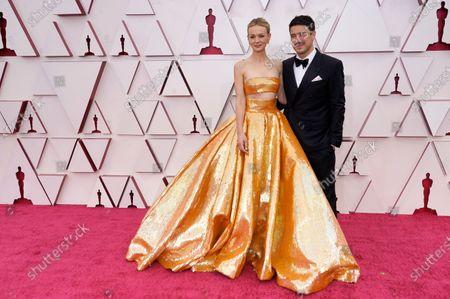 Carey Mulligan, left, and Marcus Mumford arrive at the Oscars