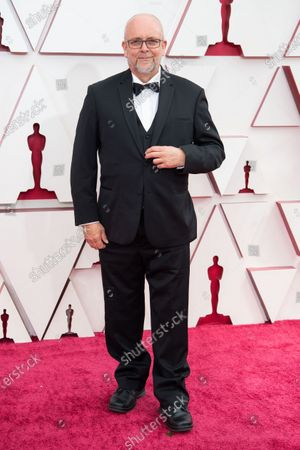 Mark Coulier arrives on the red carpet of The 93rd Oscars® at Union Station in Los Angeles, CA on Sunday, April 25, 2021.