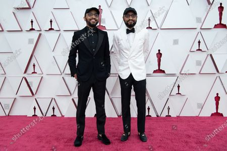 Stock Image of Oscar® nominees Kenny Lucas and Keith Lucas arrive on the red carpet of The 93rd Oscars® at Union Station in Los Angeles, CA on Sunday, April 25, 2021.