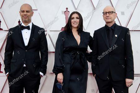Stock Image of Jesse Collins, Stacy Sher, Steven Soderbergh arrive on the red carpet of The 93rd Oscars® at Union Station in Los Angeles, CA on Sunday, April 25, 2021.