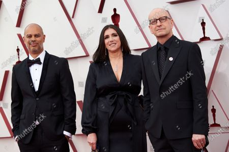 Steven Soderbergh (R), Jesse Collins (L), and Stacey Sher (C) arrive on the red carpet of The 93rd Oscars® at Union Station in Los Angeles, CA on Sunday, April 25, 2021.