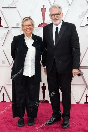 David Crank and guest arrive on the red carpet of The 93rd Oscars® at Union Station in Los Angeles, CA on Sunday, April 25, 2021.