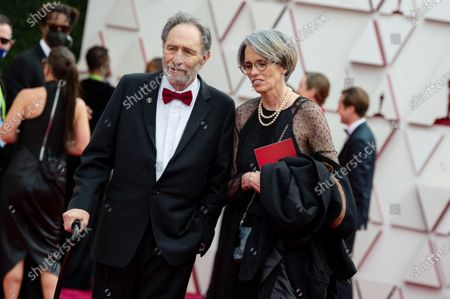 Stock Image of Eric Roth and Debra Greenfield arrive on the red carpet of The 93rd Oscars® at Union Station in Los Angeles, CA on Sunday, April 25, 2021.