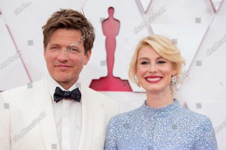 Thomas Vinterberg and Helene Reingaard Neumann arrive on the red carpet of The 93rd Oscars® at Union Station in Los Angeles, CA on Sunday, April 25, 2021.