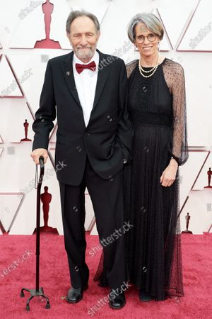 Eric Roth and guest arrive on the red carpet of The 93rd Oscars® at Union Station in Los Angeles, CA on Sunday, April 25, 2021.