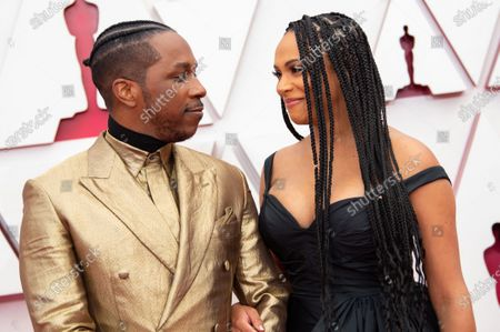 Leslie Odom Jr. and Nicolette Robinson arrive on the red carpet of The 93rd Oscars® at Union Station in Los Angeles, CA on Sunday, April 25, 2021.