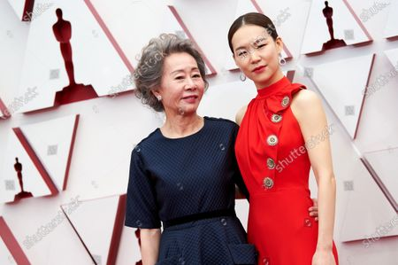 Yuh-Jung Youn arrives with Han Ye-ri on the red carpet of The 93rd Oscars® at Union Station in Los Angeles, CA on Sunday, April 25, 2021.