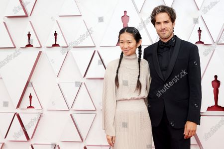 Stock Image of Oscar® nominees Chloé Zhao and Joshua James Richards arrive on the red carpet of The 93rd Oscars® at Union Station in Los Angeles, CA on Sunday, April 25, 2021.