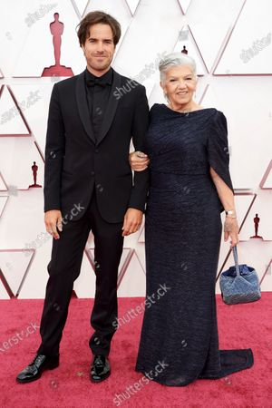 Stock Photo of Joshua James Richards and Linda May arrives on the red carpet of The 93rd Oscars® at Union Station in Los Angeles, CA on Sunday, April 25, 2021.