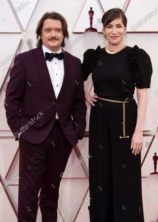 Mollye Asher, right, and guest arrive on the red carpet of The 93rd Oscars® at Union Station in Los Angeles, CA on Sunday, April 25, 2021.