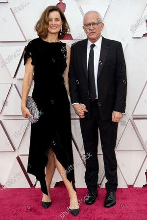 Stock Picture of James Newton Howard (R) and guest arrive on the red carpet of The 93rd Oscars® at Union Station in Los Angeles, CA on Sunday, April 25, 2021.