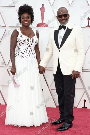 Stock Image of Viola Davis with Julius Tennon on the red carpet of The 93rd Oscars® at Union Station in Los Angeles, CA on Sunday, April 25, 2021.