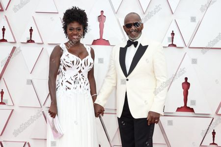 Viola Davis with Julius Tennon on the red carpet of The 93rd Oscars® at Union Station in Los Angeles, CA on Sunday, April 25, 2021.