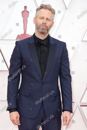 Darius Marder arrives on the red carpet of The 93rd Oscars® at Union Station in Los Angeles, CA on Sunday, April 25, 2021.