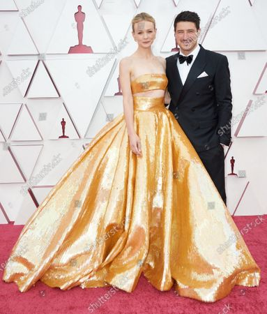 Carey Mulligan and Marcus Mumford arrive on the red carpet of The 93rd Oscars® at Union Station in Los Angeles, CA on Sunday, April 25, 2021.