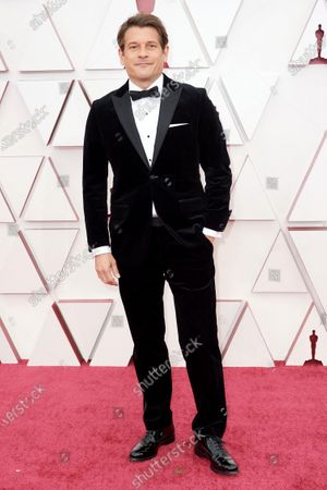 Stock Picture of Mark Ricker arrives on the red carpet of The 93rd Oscars® at Union Station in Los Angeles, CA on Sunday, April 25, 2021.