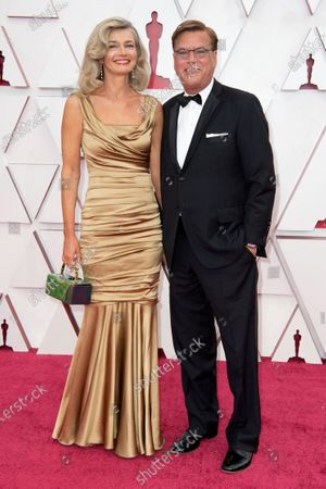 Aaron Sorkin (L) and Paulina Porizkova arrive on the red carpet of The 93rd Oscars® at Union Station in Los Angeles, CA on Sunday, April 25, 2021.