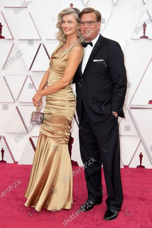 Stock Image of Aaron Sorkin (L) and Paulina Porizkova arrive on the red carpet of The 93rd Oscars® at Union Station in Los Angeles, CA on Sunday, April 25, 2021.