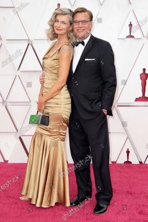 Stock Picture of Aaron Sorkin (L) and Paulina Porizkova arrive on the red carpet of The 93rd Oscars® at Union Station in Los Angeles, CA on Sunday, April 25, 2021.