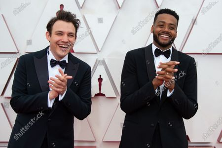 Stock Photo of Oscar® nominees Ben Proudfoot (L) and Kris Bowers (R) arrive on the red carpet of The 93rd Oscars® at Union Station in Los Angeles, CA on Sunday, April 25, 2021.